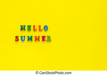 Inscription Hello Summer from colorful letters on yellow background,