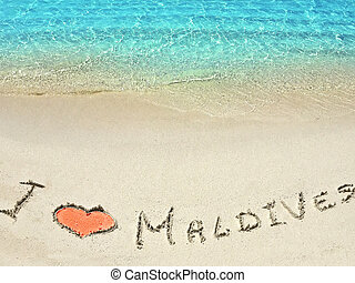 "Inscription ""I LOVE MALDIVES"" in the sand on a tropical island, Maldives."