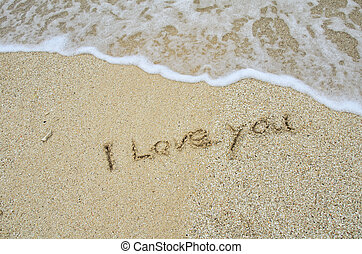 inscription I Love You on the sand at the beach.