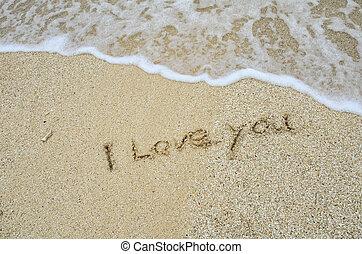 inscription I Love You on the sand at the beach.