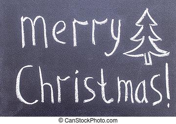 Inscription Merry Christmas on chalkboard