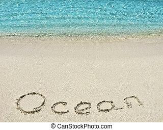 "Inscription ""Ocean"" in the sand on a tropical island,  Maldives."