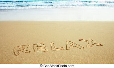 Inscription on beach sand - relax