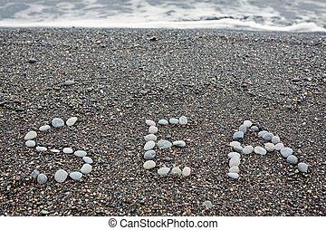 Inscription on the seashore SEA