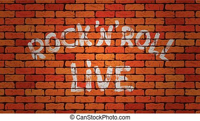 Inscription rock'n'roll live on the wall of red brick
