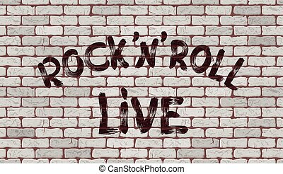 Inscription rock'n'roll live on the wall of white brick