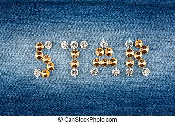 Inscription STAR made of rhinestones on jeans