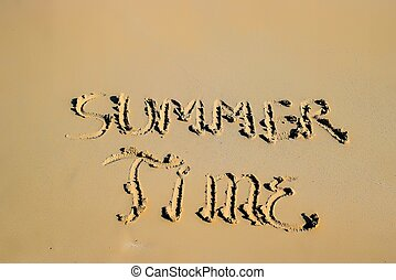 "Inscription ""Summer Time"" in the sand on a tropical island"