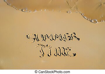 """Inscription """"Summer Time"""" in the sand on a tropical island"""
