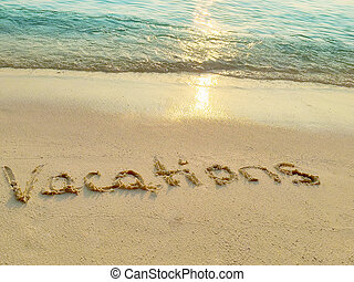 """Inscription """" Vacations"""" in the sand on a tropical island,  Maldives."""