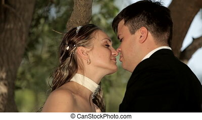 Inseparable - The newlyweds are in an embrace. Three frames.