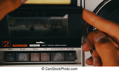 Insert Audio Cassette into the Tape Player and Pushing Play...