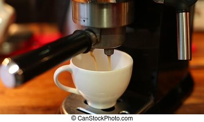 insert the Holder from the coffee into the coffee machine close up