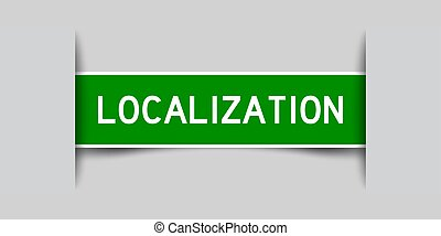 Inserted green color label sticker with word localization on gray background