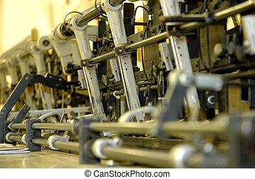 Close-up shot of an inserter machine at waist level
