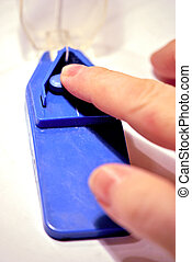 Inserting a pill into the pill cutter.