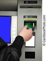 Inserting plastic card visa into ATM