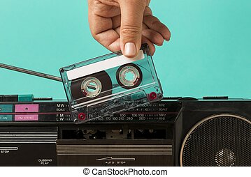 inserting tape into cassette. Resolution and high quality beautiful photo