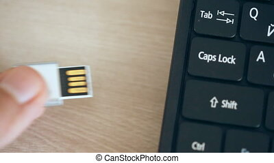 Inserting usb flash memory card into portable computer