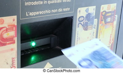 gas station - insertion of a euro banknote inside the gas...