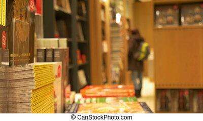 Inside a Bookstore - People inside a bookstore, illuminated...