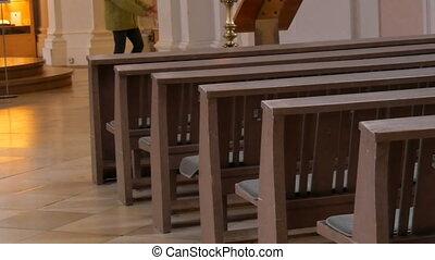 Inside an empty catholic church. Wooden pews for church...