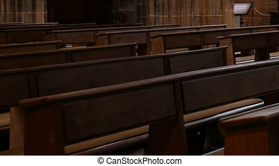 Inside an empty catholic church. Wooden pews for church...