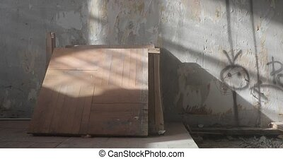 inside an old abandoned dusty room.