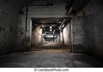 inside an old industrial building, basement with little...