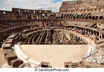 Inside arena in ancient Coliseum in Rome, Italy with occupied people at sunny day