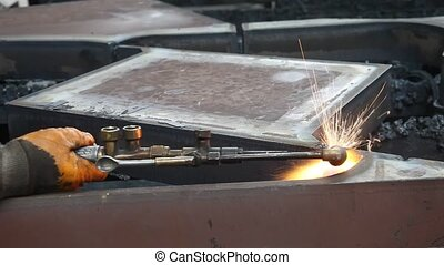 inside factory, welder with welding sparks