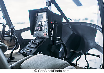 Inside helicopter cabin, control panel, side view