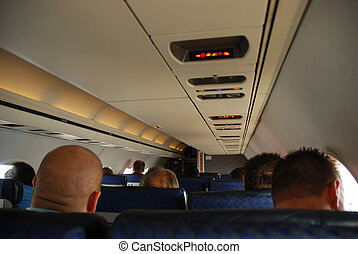 Inside of an airplane - Passengers inside of an airplane
