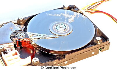 Inside of HDD - Concept of HDD data loss with water damaging...