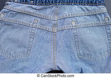 Inside of jeans on dark background.