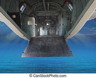 inside of military plane flying over sea