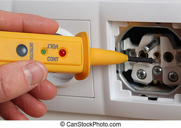 Inside of socket - Closeup of socket, checking voltage with...