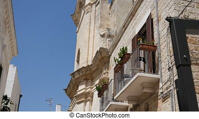 Inside old town of Polignano a Mare, Italy - Establishing...