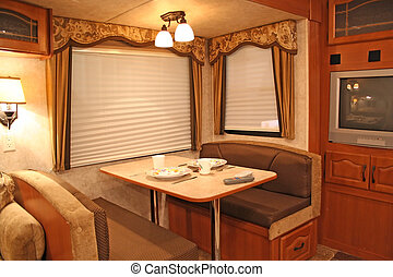 inside RV - dining - interior of a motor home showing dining...
