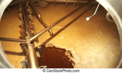 Inside the brewing boil tank. Beer production. - Inside the...