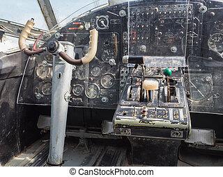 Inside the cockpit of a vintage small jet plane