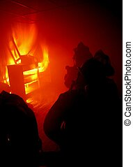 Inside the fire - Firefighters battle a structure fire.