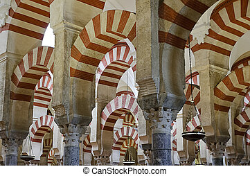 Arches and incredible architecture inside the Mezquita (the Great Mosque), one of the most famous landmarks in Andalusia