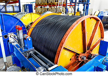 Inside the old factory manufacturing electrical cable. Outdated technology mid-20th century.