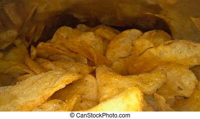 Inside the potato chips bag. Opened pack of original taste...