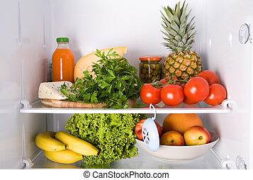 inside the refrigerator - different kind of food in the...