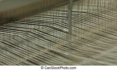 Weaving a carpet on a loom slow motion