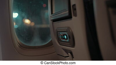 Inside view of plane with seat monitor and night lights in the illuminator