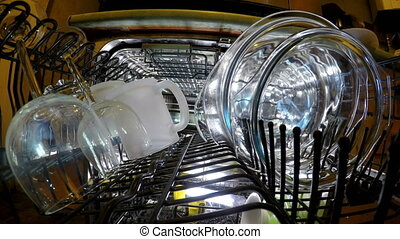 Inside view on washing of ware in the dishwasher,