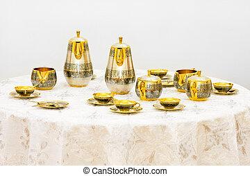 insieme tè, oro